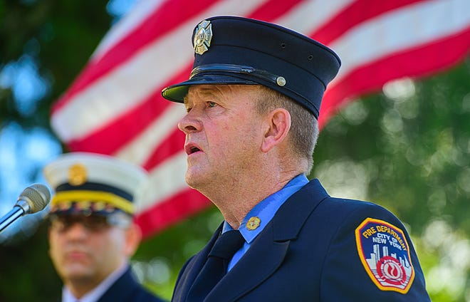 Retired New York City firefighter Gerard Durkin talks about his memories of responding to the terrorist attacks on the World Trade Center on Sept. 11, 2001 during the City of St. Augustine's annual Ceremony of Remembrance held at the St. Augustine Fire Department's main station on Malaga Street on Friday.