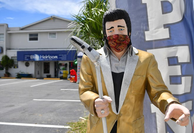 A statue of Elvis Presley – a landmark on Swift Road – stands near the street in front of The Blue Heirloom, which is celebrating two years in business this month. It's a locally owned business that features 20 different vendors inside selling things like collectibles, home furnishings, cassettes and vinyls, art and more.