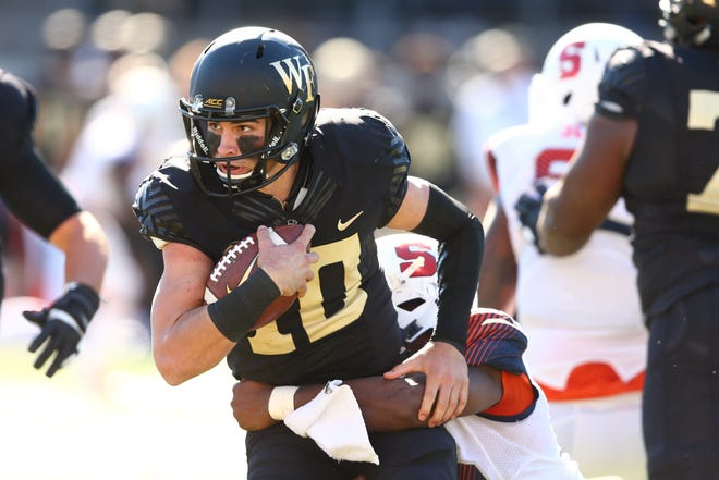 Nov 3, 2018; Winston-Salem, NC, USA; Wake Forest Demon Deacons quarterback Sam Hartman (10) carries the ball in the third quarter against the Syracuse Orange at BB&T Field.