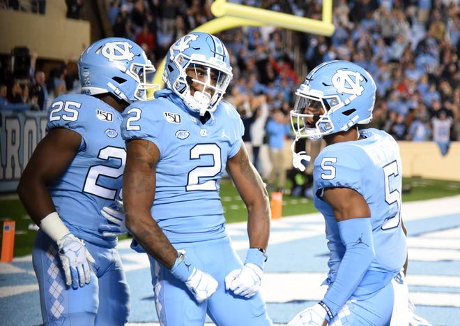 Nov 2, 2019; Chapel Hill, NC, USA; North Carolina Tar Heels receiver Dyami Brown (2) celebrates after scoring a touchdown during the first half against the Virginia Cavaliers at Kenan Memorial Stadium.
