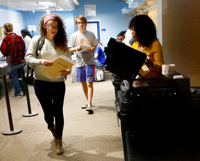 University of Florida students early vote at the Reitz Union precinct on the UF campus in 2018.