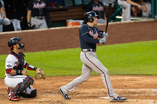 Atlanta's Freddie Freeman hits a home run against Washington on Thursday night.