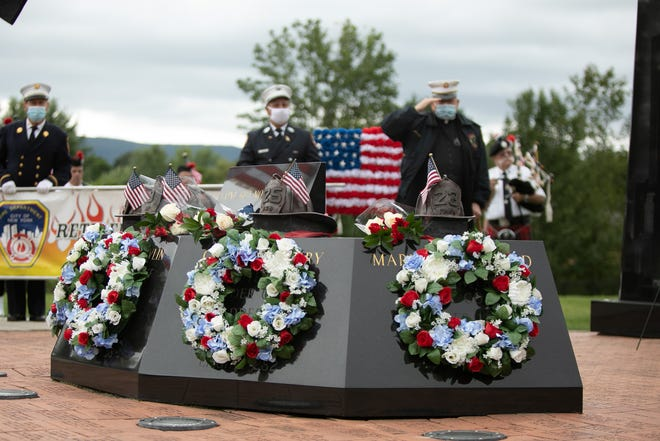 Washingtonville's 9/11 memorial is adorned with wreathes and flags during a ceremony to commemorate the men and women who lost their lives on 9/11 in Washingtonville, NY on September 11, 2020.