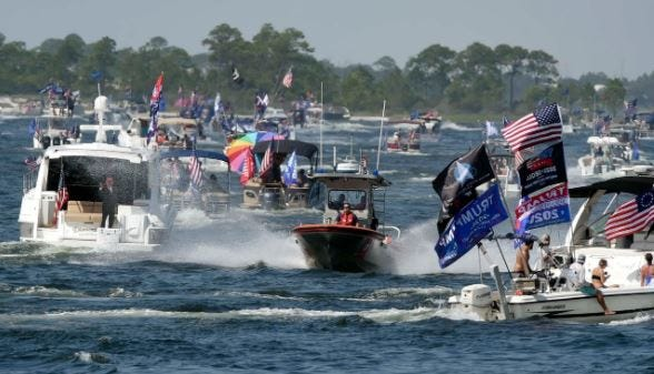 Hundreds of boaters motor down Santa Rosa Sound on their way to Navarre on Saturday for the Emerald Coast Florida Trump Flotilla.