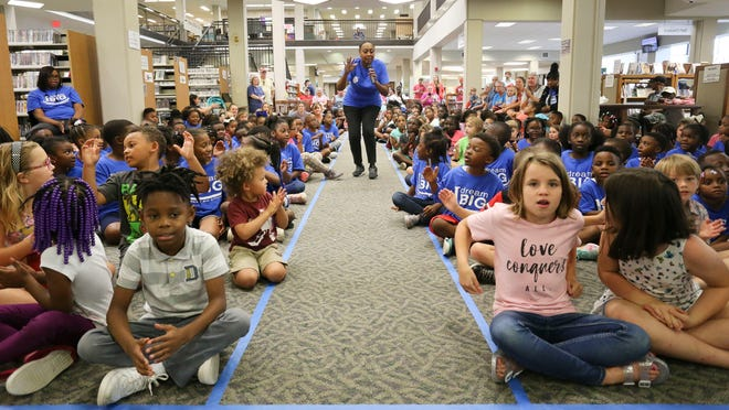 Summer Reading Programs at the Tuscaloosa Public Library, like this one led here in 2019 by B.J. Reed, the executive director of school programs and special activities for the Alabama Blues Project, could be on the chopping block as the library faces a 38% cut in funding from Tuscaloosa City Hall. [Staff file photo/Gary Cosby Jr.]