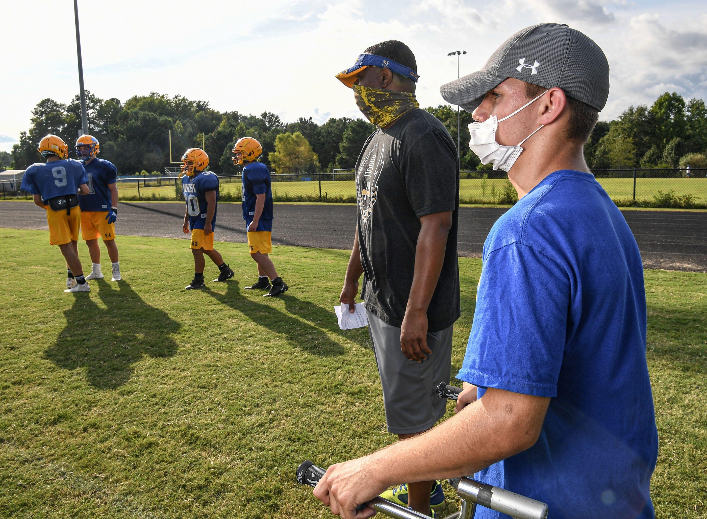 Wren football team manager Connor Monteruil watches over practice in Piedmont, S.C. September 2020.