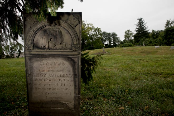 A view of the tombstone of Nancy Williams at United American Cemetery in Columbia Township on Friday, Sept. 11, 2020. According to local historian Chris Hanlin the tombstone is the oldest African American tombstone in Cincinnati. Hanlin said the tombstone was originally at the United Colored Cemetery in Avondale and was moved in 1884 to the United American Cemetery. United American Cemetery was founded in 1883.