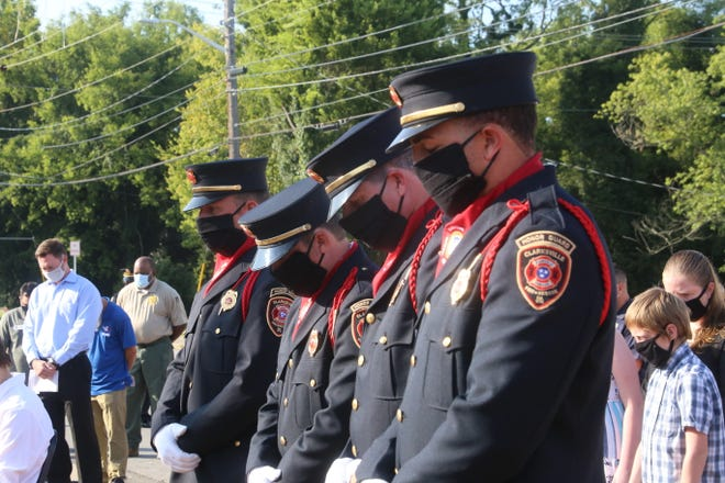 The Clarksville Fire Department honor guard stand in prayer during the 9/11 memorial ceremony on Friday, Sept. 11, 2020.