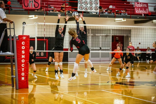 Coshocton's Kindall Shaw splits the blockers on this kill during their Thursday night match up with New Lex. The Panthers won in three sets.
