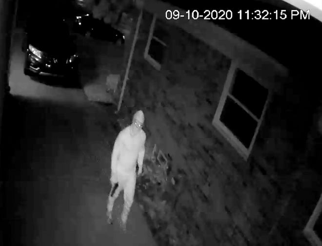 In this frame capture from a surveillance video captured a suspect firing shots at the home of a Black family in Warren at about 11:30 p.m. Sept. 10, 2020, with one bullet going through the front window.