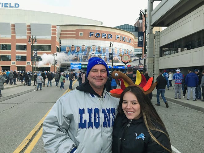 Makelle Barski, 29, of Trenton has been attending Lions games since she was 5. She is pictured here with her father, Kenneth, attending a Thanksgiving Day game.