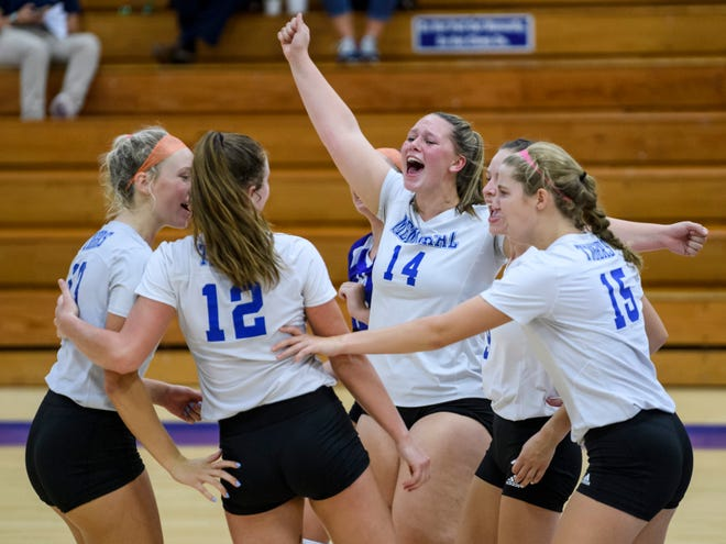 Memorial's Cadence Rasche (14) cheers with her teammates as they celebrate winning the fifth set over the North Posey Vikings, 15-7, at the Robert M. Kent Athletic Center in Evansville, Ind., Thursday, Sept. 10, 2020. The Tigers defeated the Vikings, 3-2.