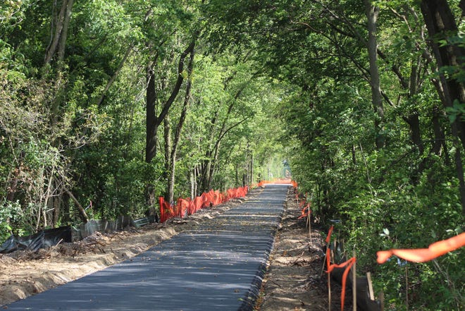 Paving work on the North Coast Inland Trail continues near Martin-Williston Road in Genoa.