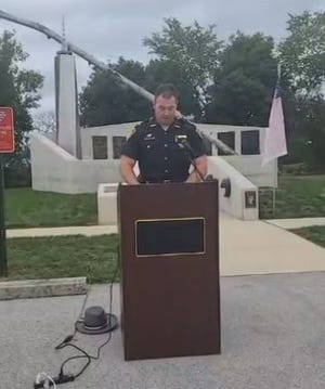 Sandusky County Sheriff Chris Hilton virtually addresses people during a ceremony to honor those who lost their lives in the 9/11 terrorist attacks.