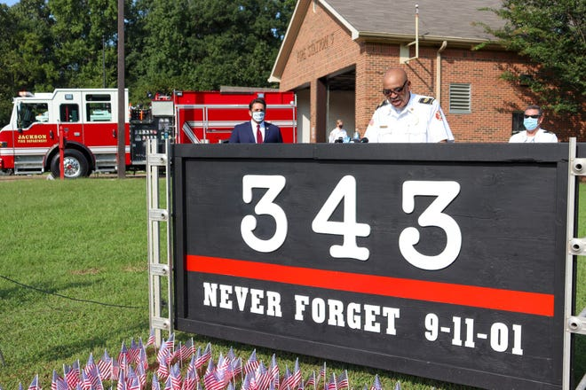 Jackson Fire Department Chief Darryl Samuels speaks in front of Station 3 during the 9/11 commemoration ceremony Friday with Mayor Scott Conger in the background.