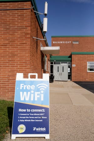 A sign outside Wainwright Middle School advertises free WiFi, Friday, Sept. 11, 2020 in Lafayette. Tippecanoe School Corp. partnered with Wintek/Tipmont to provide outdoor free, public WiFi at four schools and TSC WiFi at 14 other schools.