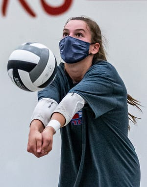 Arrowhead senior Jade Stefan works during volleyball practice last month, wearing a mask as is required of all players and coaches.