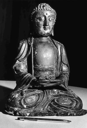 This bronze Buddha from Northern Manchuria (A.D. 900-1000, late Tang or early Sung dynasty) is part of the Milwaukee Public Museum's centennial exhibit at the Courthouse. The Buddha is from the Rudolph J. Nunnemacher Colletion bequeathed to the Museum in 1900. Milwaukee Museum Collections
