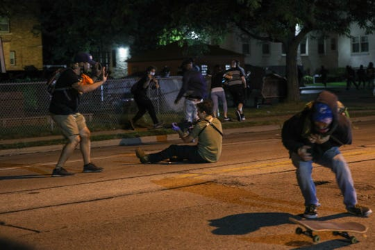 Gaige Grosskreutz, left,  was shot in the arm during protests in Kenosha. Anthony Huber, right, was shot in the chest and killed. Kyle Rittenhouse, shown on the ground, was charged in the shootings.