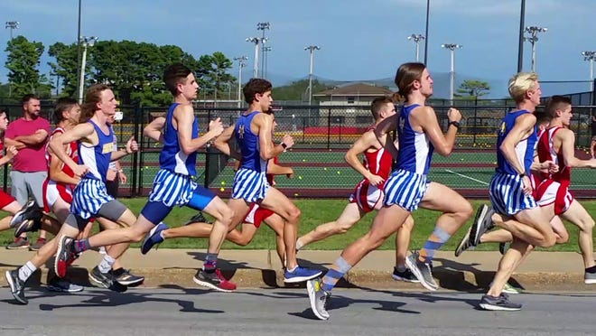 Mountain Home runners Hendrix Hughes (from left), Ky Bickford, Andrew Westphal, Tyler Firment and Whit Lawrence compete at the Carthage, Mo., Invitational on Thursday.
