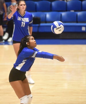 Cotter's Mai Tathong passes the ball during a recent home match against Salem. The Lady Warriors survived a five-set victory over Flippin on Thursday in a battle for first place in the 2A-North Conference.