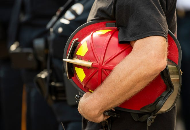 A fire helmet is held during the Montgomery Fire Rescue 9-11 Observance in downtown Montgomery, Ala., on Friday morning September 11, 2020.