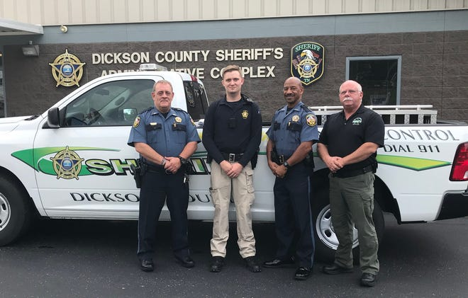 Pictured, from left, with Swaw, Patrol Lt. Mark Bausell, Chief Deputy Jerone Holt, and Patrol Captain Steve Gray.