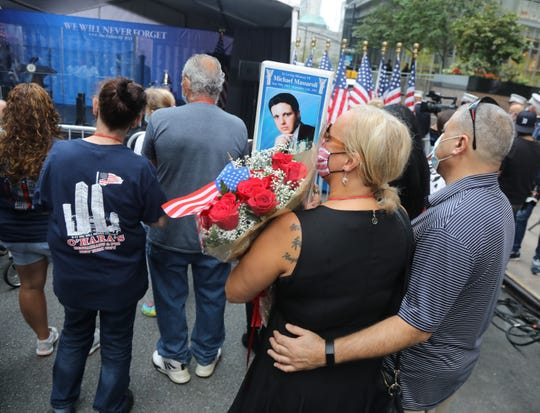 Family and supporters of those lost on 911 listen to the reading of names. The ceremony and reading the names of victims of the attacks of 911 were moved to Zuccotti Park, a block up from the World Trade Center Memorial in lower Manhattan, NY on September 11, 2020. It was sponsored by the Tunnels to Towers Foundation. This was the first time since the terror attacks of Sept. 11, 2001, there was no ceremony and reading of the names at Ground Zero because of fears of spreading the COVID-19 virus.