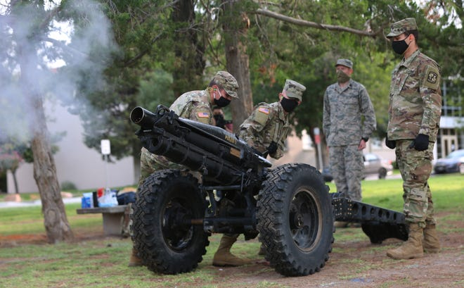 New Mexico State University ROTC cadets fire a cannon on Friday, Sept. 11, 2020, in remembrance of the Sept. 11, 2001, terrorist attacks on the United States.