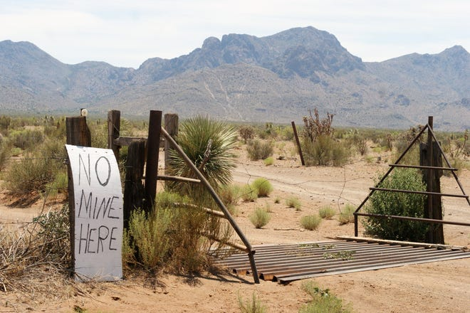 A sign protesting a proposed dolomite mine near the entrance to a road leading to the proposed site on federal land in Luna County, N.M., is seen in a June 2017 file photo.