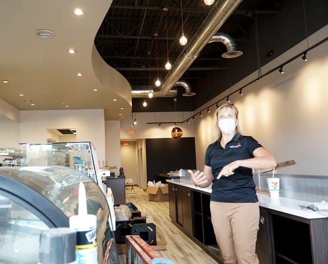 Karen Racinski inside her soon-to-open Sweetwaters at Novi Town Center.