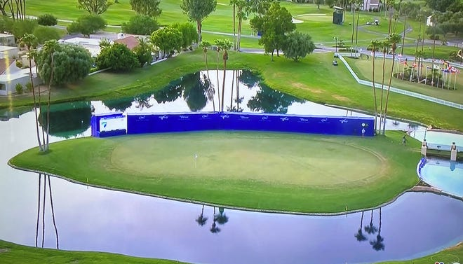 The blue wall behind the 18th green at the ANA Inspiration during a Golf Channel broadcast.