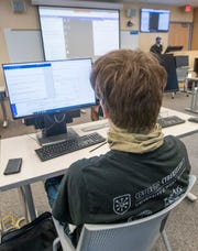 """Stephen Sonderegger listens Thursday at an """"Intro to Cybersecurity"""" class at the University of West Florida in Pensacola."""