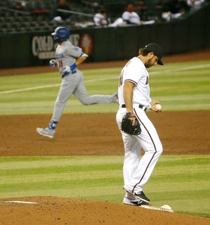 Dodgers' AJ Pollock (11) runs the bases after hitting a solo home run off of Diamondbacks' Madison Bumgarner at Chase Field in Phoenix, Ariz. on Sept. 10, 2020.
