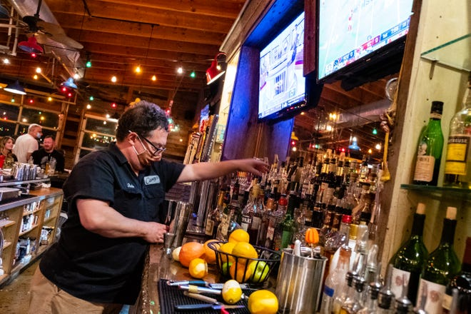 Casey's bartender Bob Nickerson makes an assortment of shots during the first NFL game Thursday, Sept. 10, 2020, at Casey's in Port Huron.