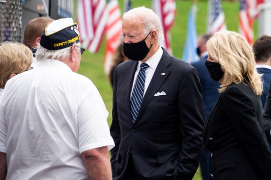 Former Vice President Joe Biden and Dr. Jill Biden talk with people during a visit to the Shanksville Volunteer Fire Department on Friday, September 11, 2020.
