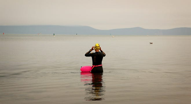 "Andi Bertolina undertakes the swimming portion of her ""Tahoe Trifecta"" attempt out of South Lake Tahoe on Sept. 10, 2020. The trifecta consists of three laps around Lake Tahoe. First, a twelve day/six mile per day swim around the perimeter of the lake, then cycling around the lake and eventually running around the lake in consecutive days."