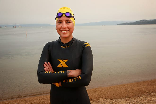 "Andi Bertolina poses for a portrait before undertaking the swimming portion of her ""Tahoe Trifecta"" attempt out of South Lake Tahoe on Sept. 10, 2020. The trifecta consists of three laps around Lake Tahoe. First, a twelve day/six mile per day swim around the perimeter of the lake, then cycling around the lake and eventually running around the lake in consecutive days."