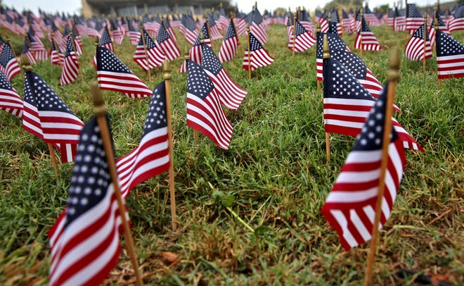 American flags representing those who lost their lives in the 9/11 attacks surround the memorial in San Angelo on Friday, Sept. 11, 2020.