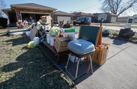 The contents of a home sit out on a driveway after an eviction in early December, 2019.