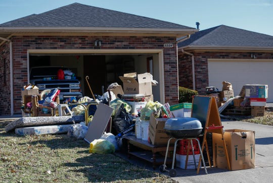 The contents of a home sit out on a driveway after an eviction in early December 2019.