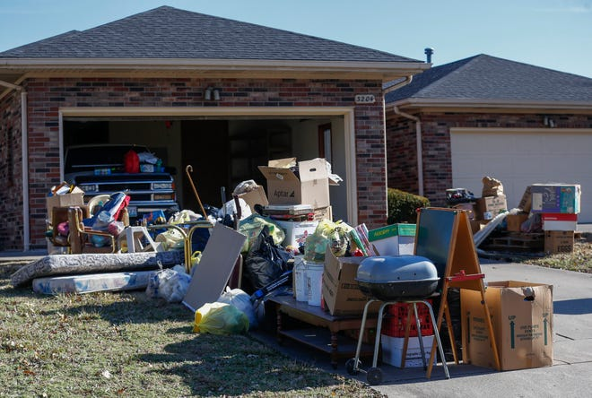 The contents of a home sit out on a driveway after an eviction in early December 2019. Amid the Delta variant COVID-19 outbreak and the expired eviction moratorium, Springfield community groups and renters are scrambling for assistance in paying rent.