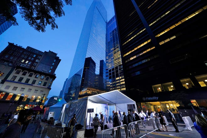 Security personnel prepare the venue where Vice President Mike Pence and his wife, Karen, will attend a ceremony organized by the Tunnel to Towers Foundation, Friday, Sept. 11, 2020, in New York. The names of nearly 3,000 victims of the Sept. 11, 2001 terror attacks are being read by family members.
