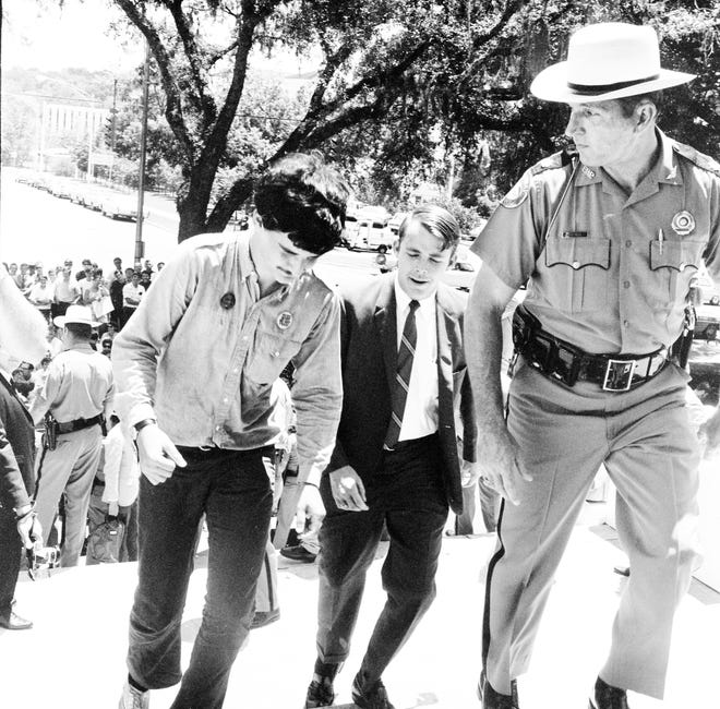 Jack Lieberman being escorted to meet with Governor Claude Kirk during protests of Vietnam War in 1969.