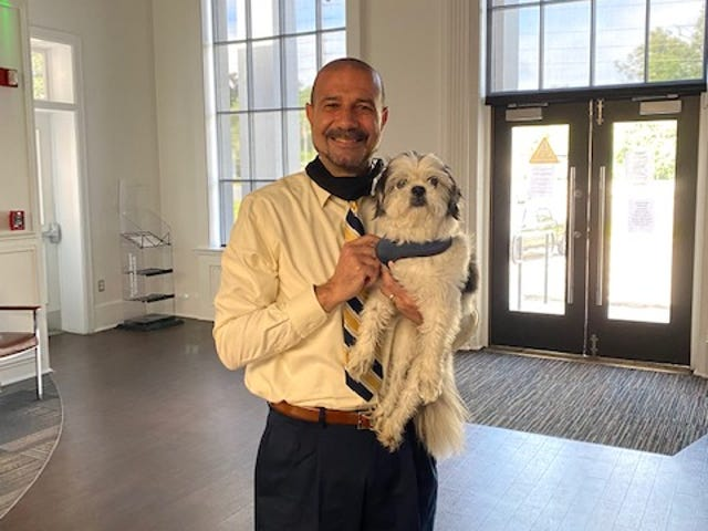 Leon County Schools Superintendent Rocky Hanna rescued Quincy, a shih tzu, from traffic on Magnolia Drive.