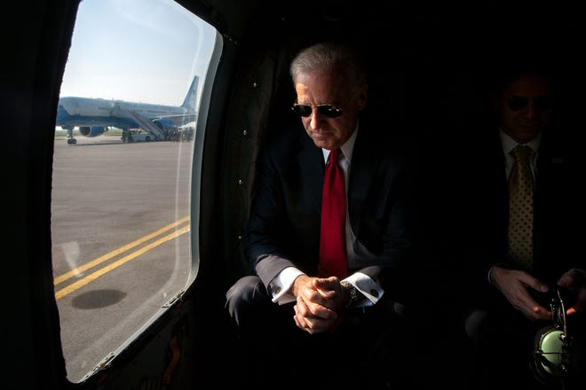 Vice President Joe Biden talks to National Security Advisor Tony Blinken as their helicopter lands at Pristina Airport in Kosovo, Friday, May 22, 2009. (White House Photo by David Lienemann)