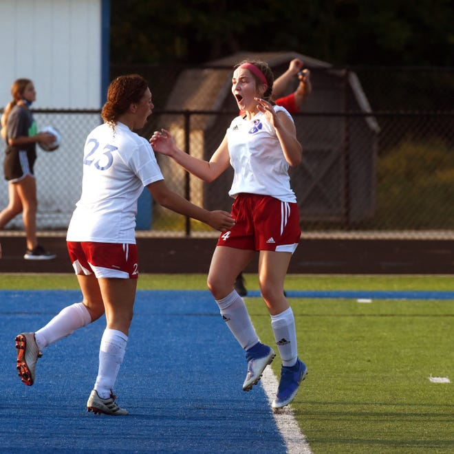 Kylee White, left, celebrates with Tori Mooney after the go-ahead goal in the first half during visiting Licking Valley's 4-1 win against Zanesville on Thursday at John D. Sulsberger Memorial Stadium.