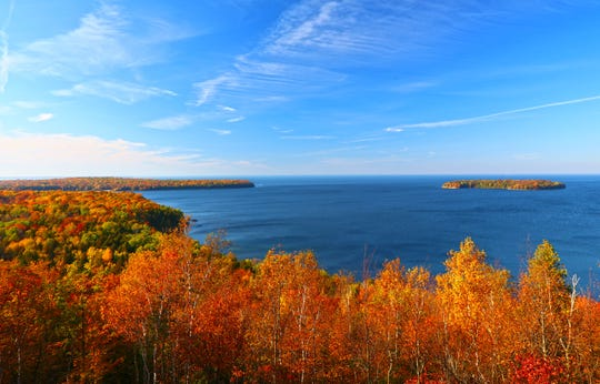 5. Door County, Wisconsin. Wisconsin's best fall foliage can often be found in Door County. Leaves reach their peak of color between late September and mid-October, when visitors from around the country come to drive its tree-lined roads or hike its trails.