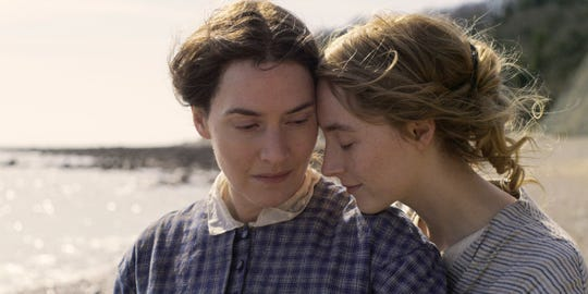 "A paleontologist (Kate Winslet, left) and a wealthy young wife (Saoirse Ronan) fall in love in the romance ""Ammonite."""