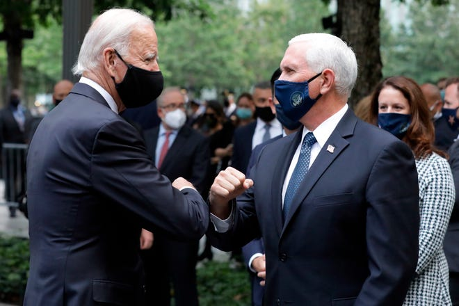 Joe Biden greets Vice President Mike Pence at the 19th anniversary ceremony in observance of the Sept. 11 terrorist attacks at the National September 11 Memorial & Museum in New York on Sept. 11, 2020.